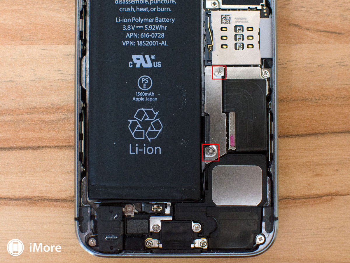 Removing screws holding the batteries in iPhone 5S