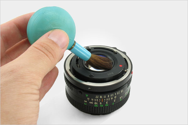 Cleaning digital camera lens